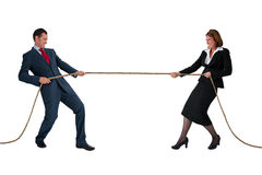 Businessman and woman tug of war isolated on white. Businessman and women tug of war rivalry concept isolated on white Royalty Free Stock Photography