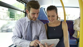 Businessman And Woman Using Digital Tablet On Bus stock video