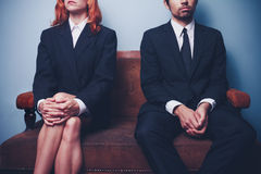 Businessman and woman waiting on sofa in lobby Royalty Free Stock Photography