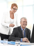 Businessman and Woman working on Royalty Free Stock Photos