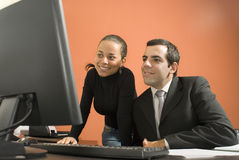 Businessman and Woman Working - Horizontal Royalty Free Stock Image