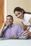 Businessman And Woman Working In Office Stock Photos