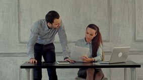Businessman and woman working together in the stock footage