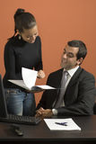 Businessman and Woman Working - Vertical Royalty Free Stock Images