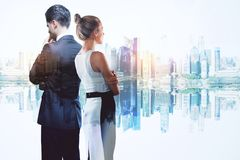 Teamwork and success concept. Businessman and women on abstract reflected city background. Teamwork and success concept. Double exposure Royalty Free Stock Photos