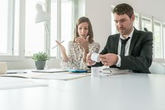 Businessman and woman doing their accounts Royalty Free Stock Photo