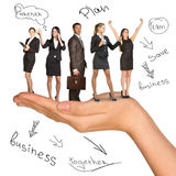 Businessman and women in humans hand Royalty Free Stock Photography