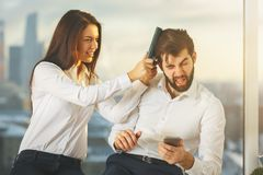 Fun concept. Businessman and women playing at workplace. Fun concept royalty free stock images