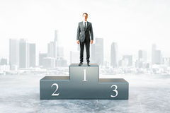 Businessman won competition. Businessman on first place pedestal and city background. 3D Rendering Stock Photo
