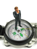 Businessman wondering where to go next. A businessman standing on a compass wondering where to go next royalty free stock photo