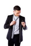 Businessman wonders which necktie to choose Royalty Free Stock Images