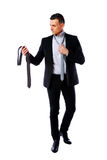 Businessman wonders which necktie to choose. Handsome businessman wonders which necktie to choose Stock Images