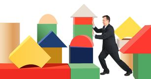 Businessman in wood toy cubes city Royalty Free Stock Photos