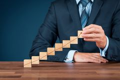 Business growth. Businessman with wooden cubes with increasing graph stock images
