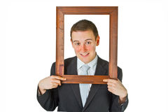 Businessman with wooden frame Royalty Free Stock Photos