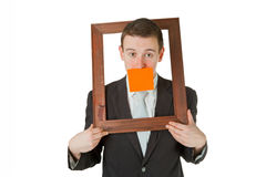 Businessman with wooden frame Royalty Free Stock Photography