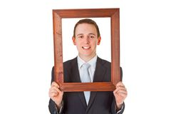 Businessman with wooden frame Stock Image