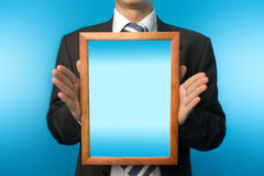 Businessman with wooden frame Stock Photography