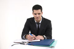 Businessman at work. With phone and documents Royalty Free Stock Images