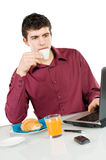 Businessman at work with breakfast Stock Photos