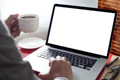 Businessman at work and computer  at home Laptop with blank scre. En on table Stock Image