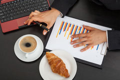 Businessman at work with cup of coffee Stock Photography