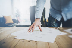 Businessman at work. Holding pencil in his hand. Architectural project on table. Blurred background, horizontal mockup. Royalty Free Stock Photo