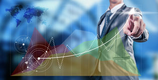 Businessman work with line chart Stock Photo
