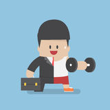 Businessman between work mode and exercise Stock Photo