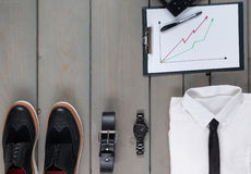 Businessman, work outfit on grey wooden background. White shirt with black tie, watch, belt, oxford shoes, planchette. And calculator. Back to work. Copy space Stock Photography