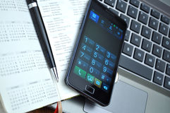 Businessman work space. A laptop, smartphone, diary and a pen on a table Royalty Free Stock Photo