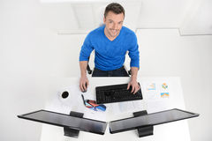 Businessman at work. Top View of young cheerful businessman sitt Royalty Free Stock Photo