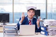 The businessman workaholic struggling with pile of paperwork. Businessman workaholic struggling with pile of paperwork Royalty Free Stock Photos