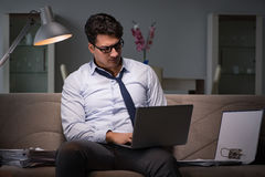 The businessman workaholic working late at home Royalty Free Stock Photography