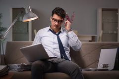 The businessman workaholic working late at home Stock Photos