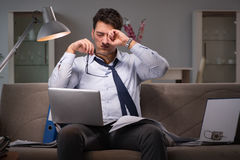 The businessman workaholic working late at home Royalty Free Stock Images