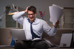 The businessman workaholic working late at home. Businessman workaholic working late at home Royalty Free Stock Image