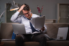 The businessman workaholic working late at home. Businessman workaholic working late at home Stock Photography