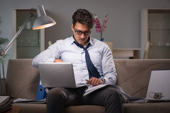 The businessman workaholic working late at home. Businessman workaholic working late at home Royalty Free Stock Photo