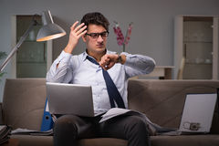 The businessman workaholic working late at home. Businessman workaholic working late at home Royalty Free Stock Photos