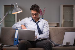 The businessman workaholic working late at home. Businessman workaholic working late at home Stock Photos
