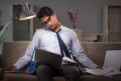 The businessman workaholic working late at home. Businessman workaholic working late at home Royalty Free Stock Images