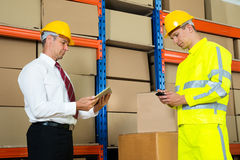 Businessman And Worker With Digital Tablet And Mobile Phone Royalty Free Stock Images