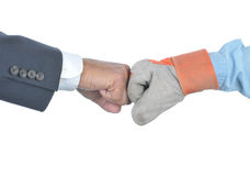 Businessman and Worker Fist Bump Stock Images