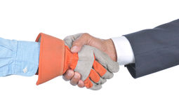 Businessman and Worker Handshake Stock Images