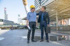 Businessman worker handshaking on construction site Stock Photos