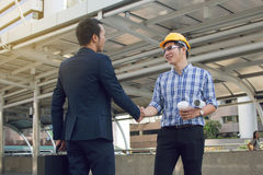 Businessman worker handshaking on construction site Royalty Free Stock Image