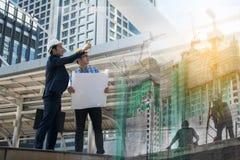 Businessman worker handshaking on construction site Stock Image