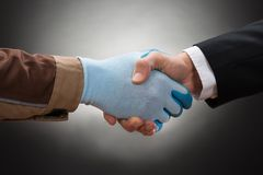 Businessman and worker shaking hand Royalty Free Stock Photos