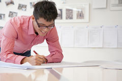 Businessman working on architecture project in the office Royalty Free Stock Image